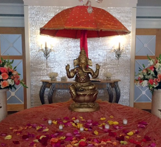 Ganesha elephant wedding reception decoration sits on a welcome table in PineCrest's foyer outside the ballroom.