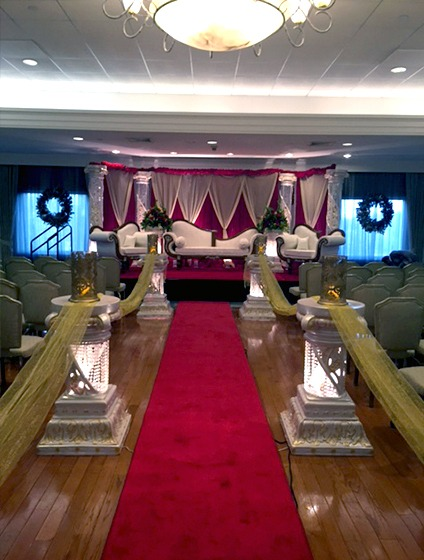 PineCrest's ballroom decorated with traditional Indian wedding sofas for South Asian pre-wedding celebrations.