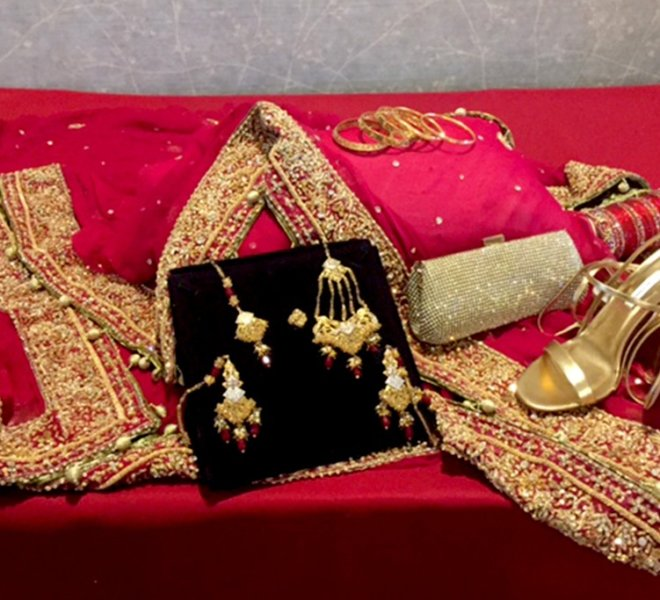 Red and gold wedding jewelry and shoes for a South Asian wedding at PineCrest.