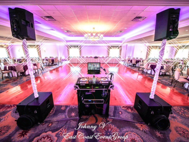 DJ set up and dance floor in a brightly lit reception hall at Pinecrest Country Club near Philadelphia