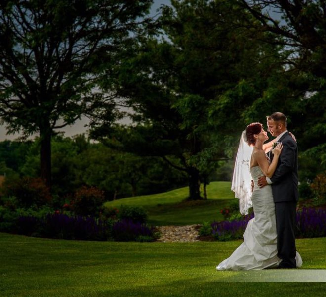 wedding couple poses on the golf course at Pinecrest Country Club a wedding party space near Bucks County PA