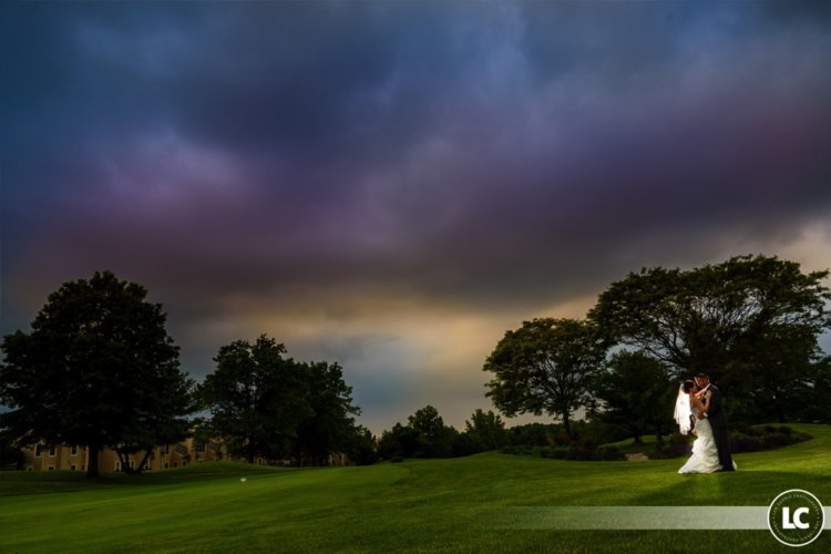 bride and groom at sunset on the golf course at Pinecrest Country Club, elegant wedding venue in Lansdale PA