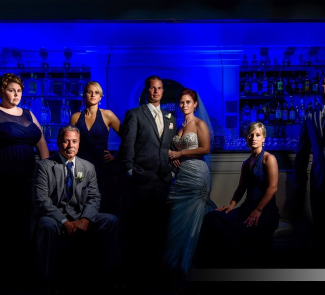 bridal party posed in front of a bar at Pinecrest Country Club, a wedding venue and party space near Bucks County PA