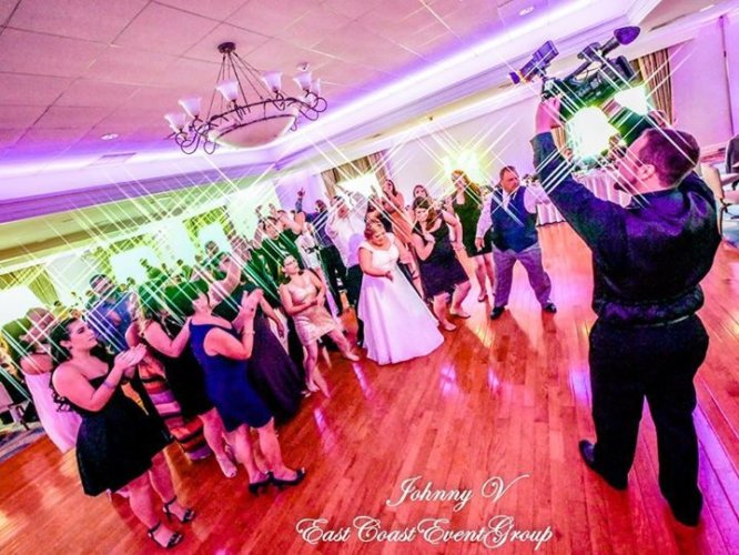 Pinecrest Country Club wedding guests dancing with the bride at a party space near Bucks County