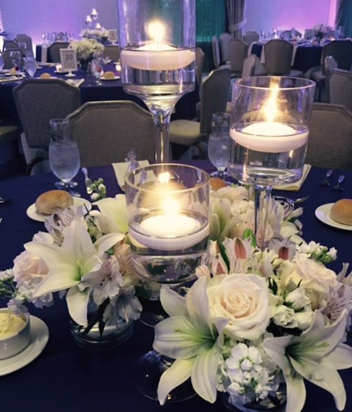Close up of a candle centerpiece in the PineCrest ballroom, decorated for a special occasion