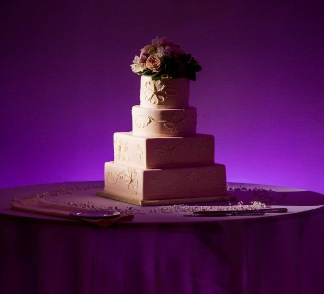 Four tier white wedding cake for celebration at PineCrest in Lansdale, PA