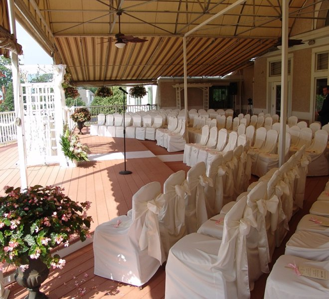The Veranda, a covered terrace and outdoor wedding event space at PineCrest.