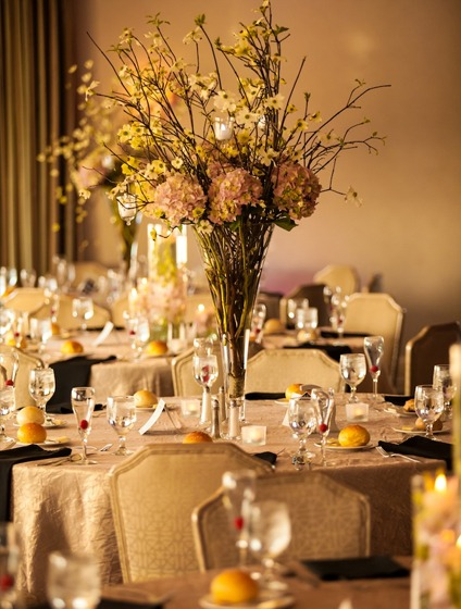 a tall floral centerpiece in one of PineCrest's wedding reception spaces.