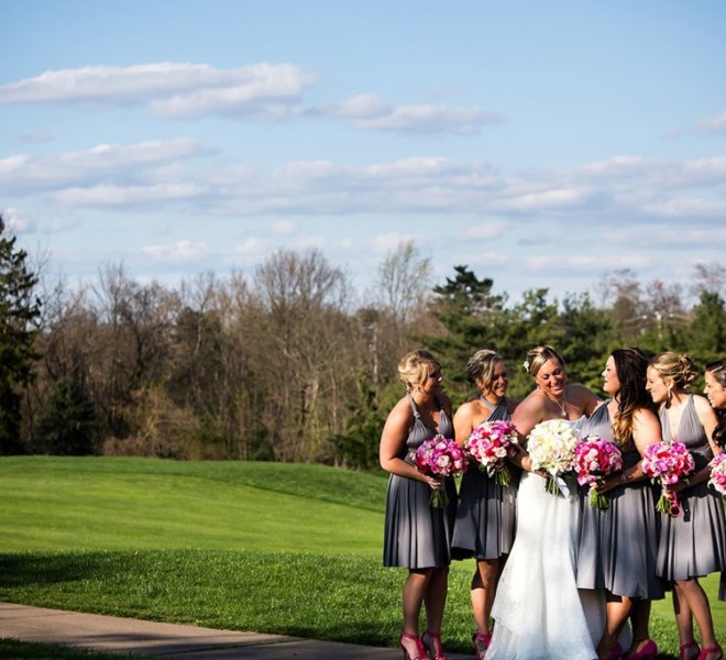 Bridal party of five standing on PineCrest's golf course near Bucks County.