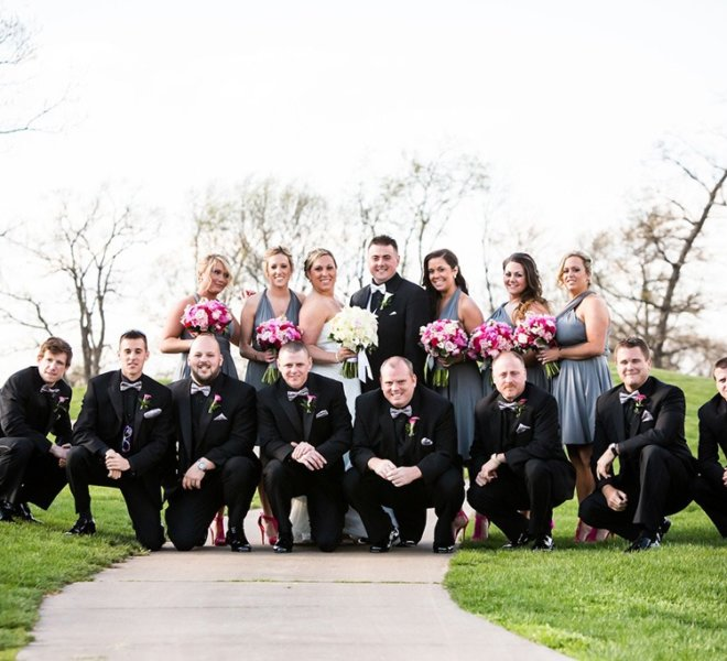 Large wedding party posing for pictures on PineCrest's golf course in Montgomery County, PA