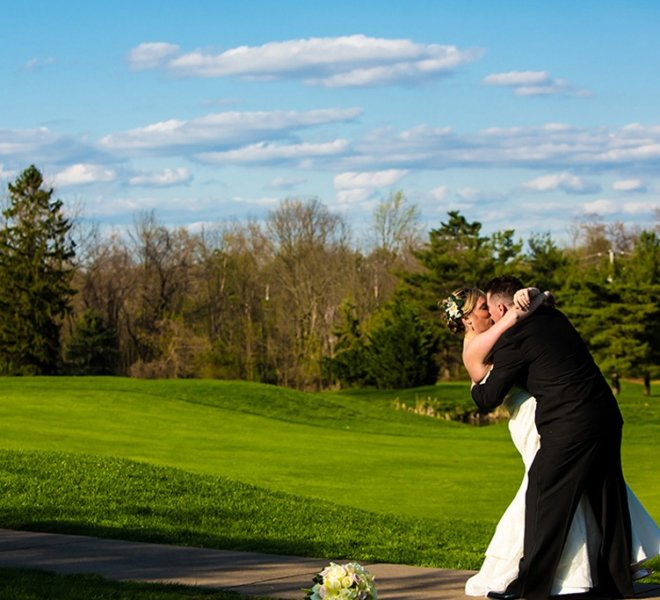 PineCrest wedding couple taking pictures on the golf course, a spectacular view from all wedding reception event spaces.