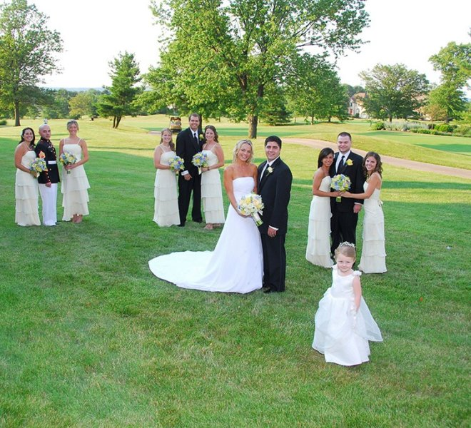 Bridal party poses for photographs at PineCrest's wedding reception venue and golf course