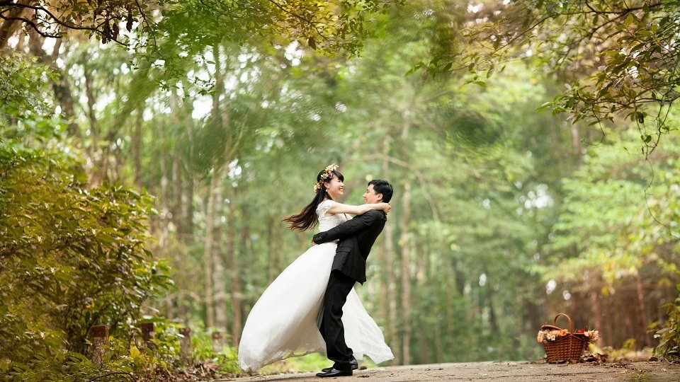 outdoor wedding photo on path surrounded by trees