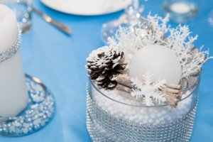 winter themed center piece with snowflake and pinecone