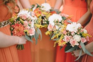 Bridal Party flowers in bright oranges