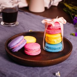 stack of three delicate, colorful macarons tied with a ribbon
