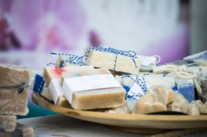 plate of custom scented soaps wrapped for party favors
