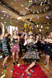 party guests dance under confetti at a bat mitzvah party