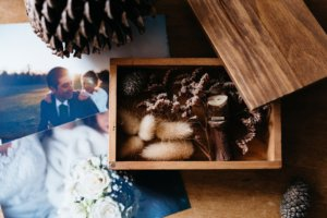Photograph of a wedding couple on a table with other decorative memory box items