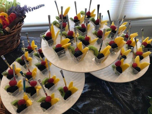 Assorted fruit cups on display at a PineCrest wedding or special event.