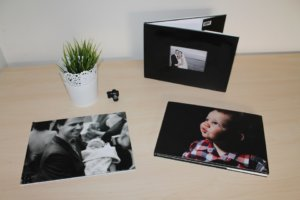 Personal photographs of milestones on a table.