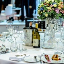 Elegant, formal dinner setting with chilled wine on the table.