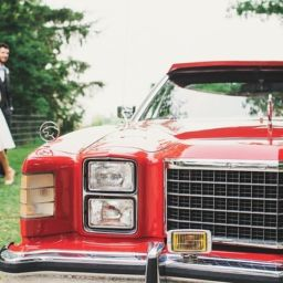 luxury, classic red car for wedding transportation
