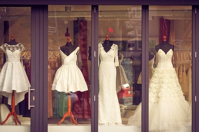 Four wedding dresses in a storefront window