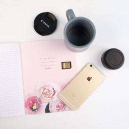 cell phone and flower notebook wedding planning