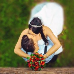wedding couple embrace with a kiss