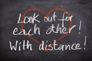 """Written in Chalk """"Look out for each other! with Distance!"""""""