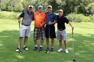 group of 4 golfers on golf course