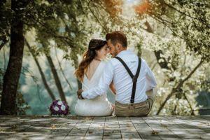 wedding couple sitting on dock