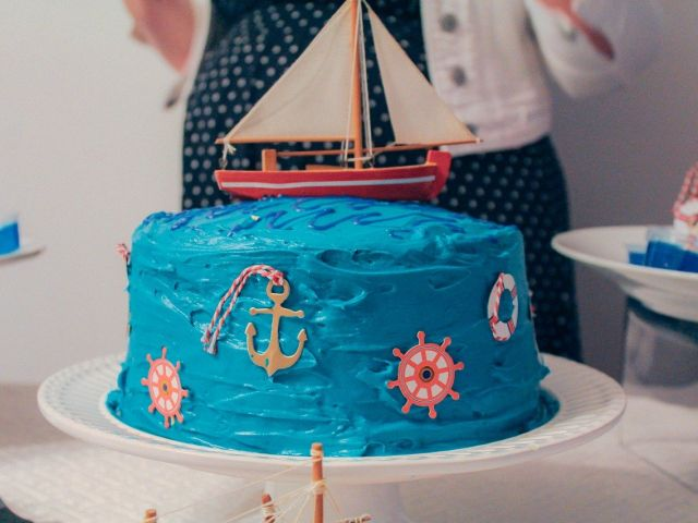 Bright blue, nautical themed cake at a summer baby shower