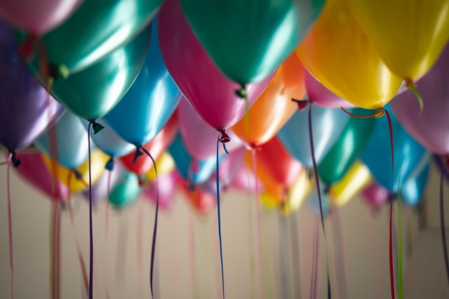 Colorful balloons hanging from the ceiling